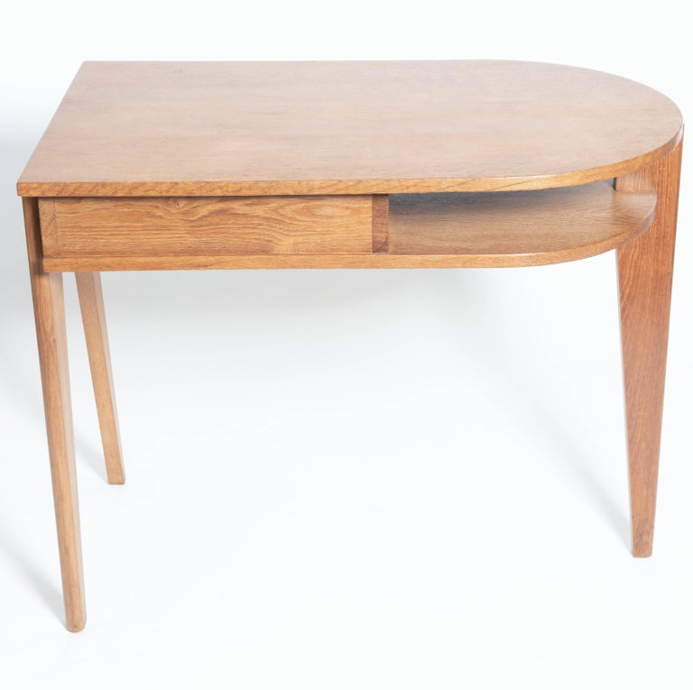 Oak desk with three legs, in the manner of Jean Prouve, France.