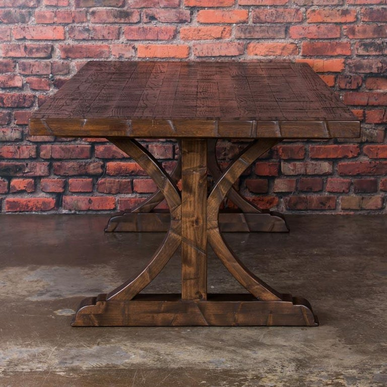 This impressive 8' long dining table was custom-made using old reclaimed oak boxcar flooring. The distressed wood is a result of years of moving cargo through the train's boxcars resulting in a modern dark, rich dining surface. It has been sanded,