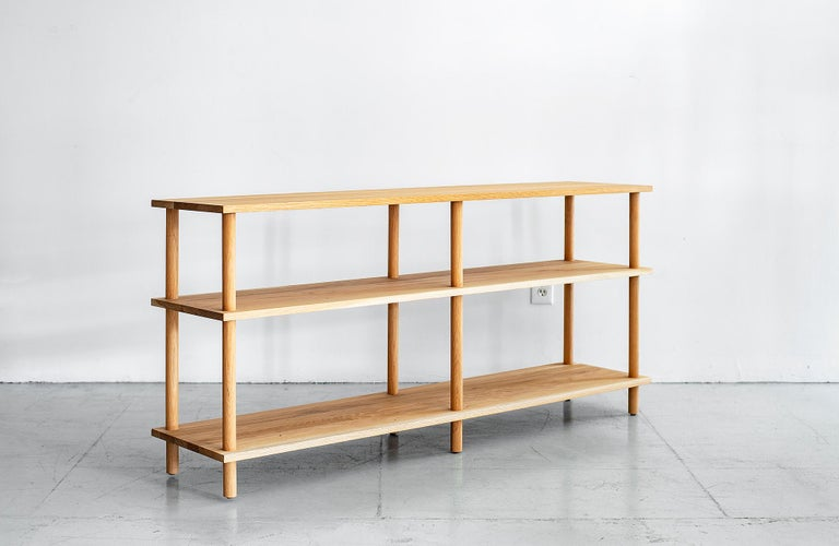 Handsome newly produced bookcase in French white oak.  Can be used as bookshelf or console.  Waxed finish. Beautiful wood with great grain detail.  Functional piece with three shelves. Great for the home or office.