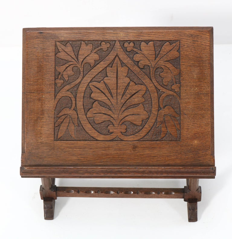Stunning Gothic Revival lectern or book stand. Striking Dutch design from the 1900s. Solid oak with wonderful handcrafted carving. In very good condition with minor wear consistent with age and use, preserving a beautiful patina.