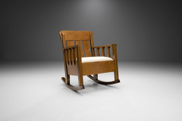 This rocking chair is a special piece of the H. Collection, for as it shows early implications of Modernism while still keeping the quintessential characteristics of the Jugendstil.  Art Nouveau, known in different languages by different names,
