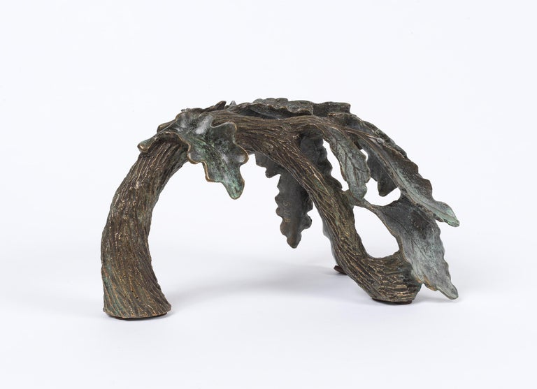 A beautiful branch of oak leaves cast in bronze. Made with the ancient lost wax method, a process dating back to the 3rd millennium BC, in which the oak leaves are carved in wax then set in clay. The wax is then melted and drained out leaving a