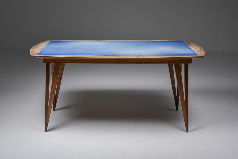 Early Mid-Century Modern dining table, solid oak, blue Formica top, Italy, 1940s  Unusual dining table from the 1940s on pin legs with a blue Formica top in original condition.  The legs and frame are solid oak, which have gained an unmatched