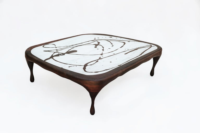 Splash coffee table sculptedby Francesco Perini Materials: Oak, marble Dimensions: H 40 x W 140 cm  Following a creative path that grew out of the founding of a company, I Vassalletti, known the world over for its extraordinary creations,