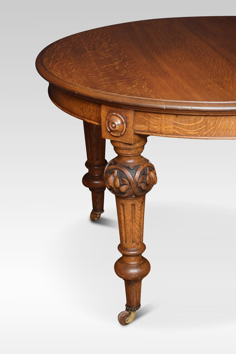 British Oak Oval Extending Dining Table For Sale