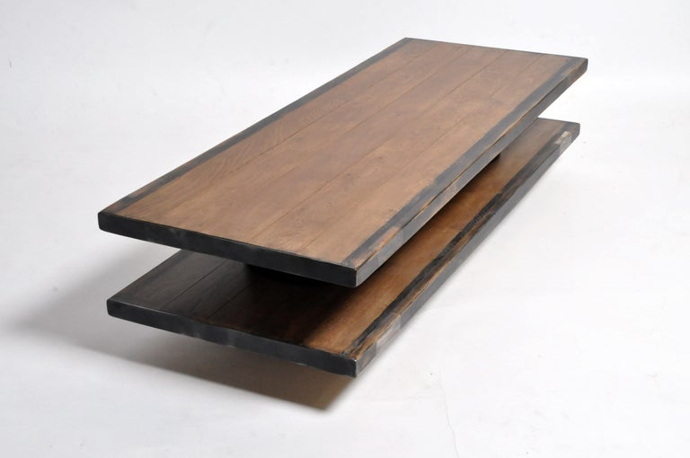 This handsome newly made coffee table is from France and made from oakwood and metal. The table features a metal trim and painted edges. Strong and sturdy table ready for everyday usage.