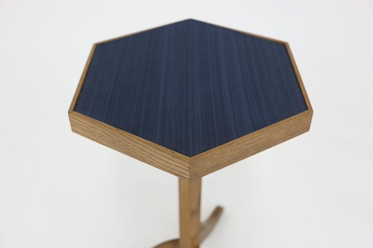 The Morgan side table has a hexagon shaped top shown covered in horsehair. All hand carved oakwood with shaped pedestal base and legs. Available as is for price as shown. Can be made custom.