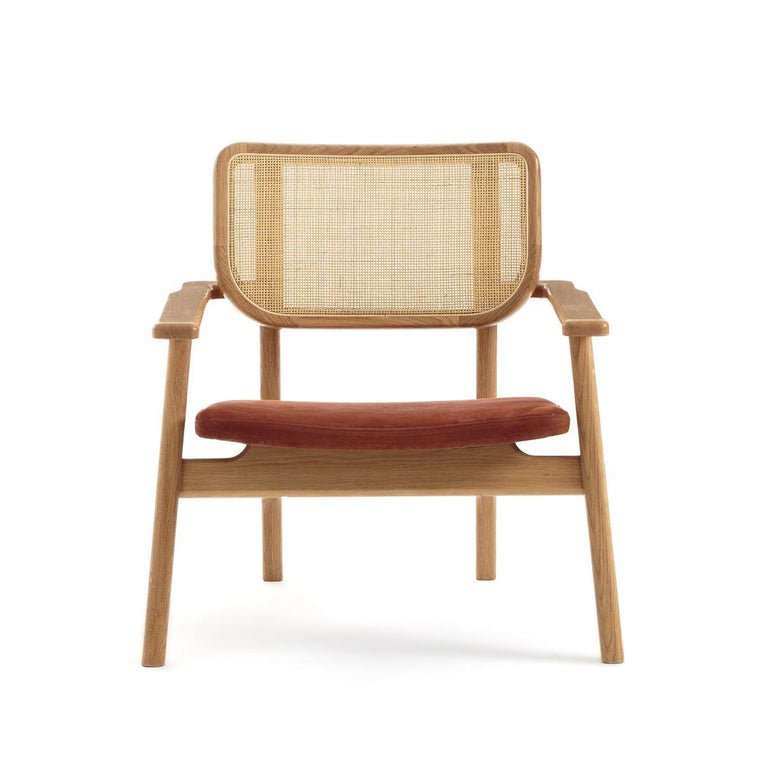 Oak wooden wicker cane and leather armchair French design and midcentury style composed of an oak wooden airy structure with welcoming shape, wicker cane back and comfy leather seat... Elegant, trendy colors and comfortable!