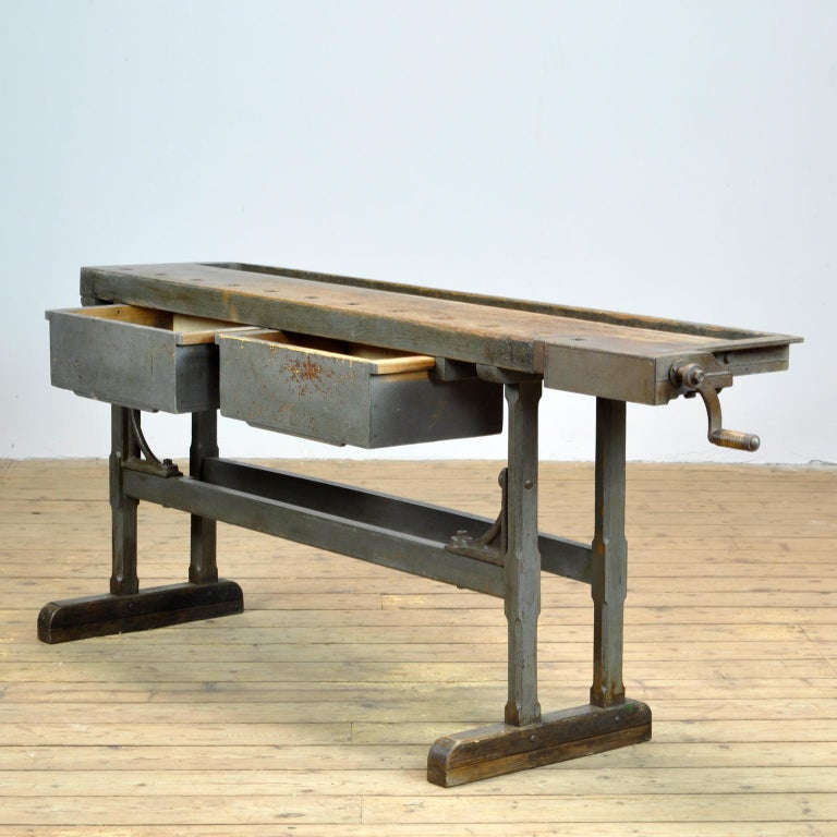 This antique workbench has a built-in iron vise and a recessed tray where the carpenter would put his tools. It was made circa 1920. Made of oak ans iron. With beautiful iron details. Very nice vintage condition.