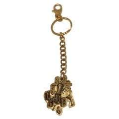 Obey gold tone key chain / accessories