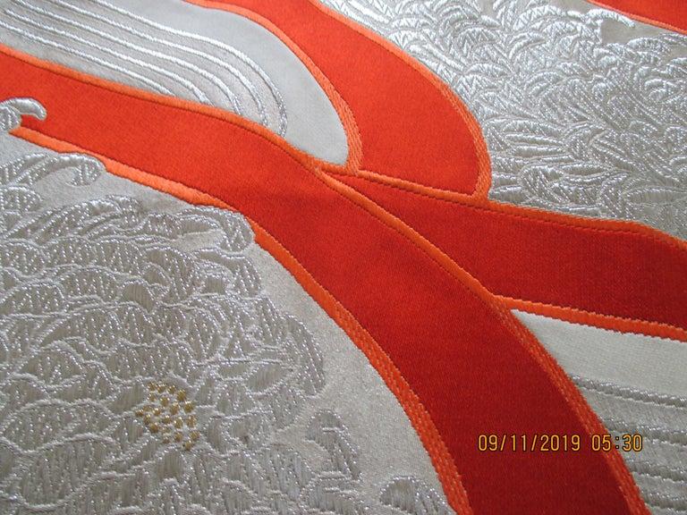 Obi textile white and orange undulating pattern. The patter design is 14