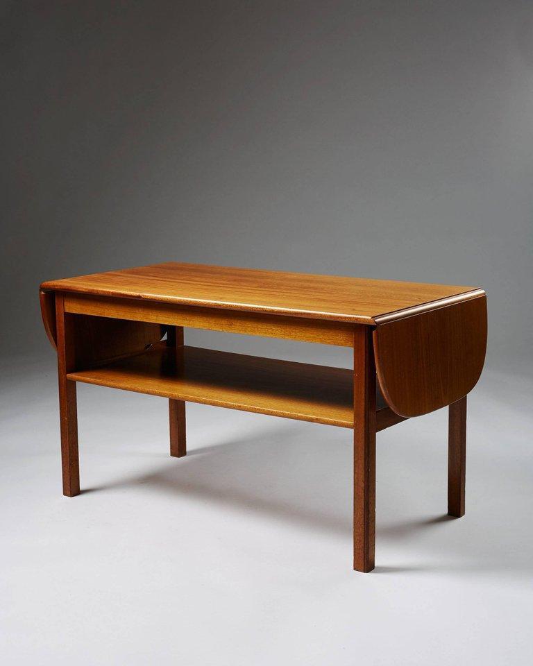 Occasional table designed by Josef Frank for Svenskt Tenn,  Sweden, 1950s.  Mahogany.