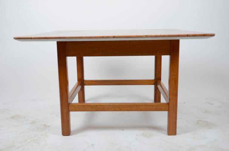 An occasional table with marble top. Designed by Josef Frank for Firma Svenskt Tenn, 1940s-1950s.