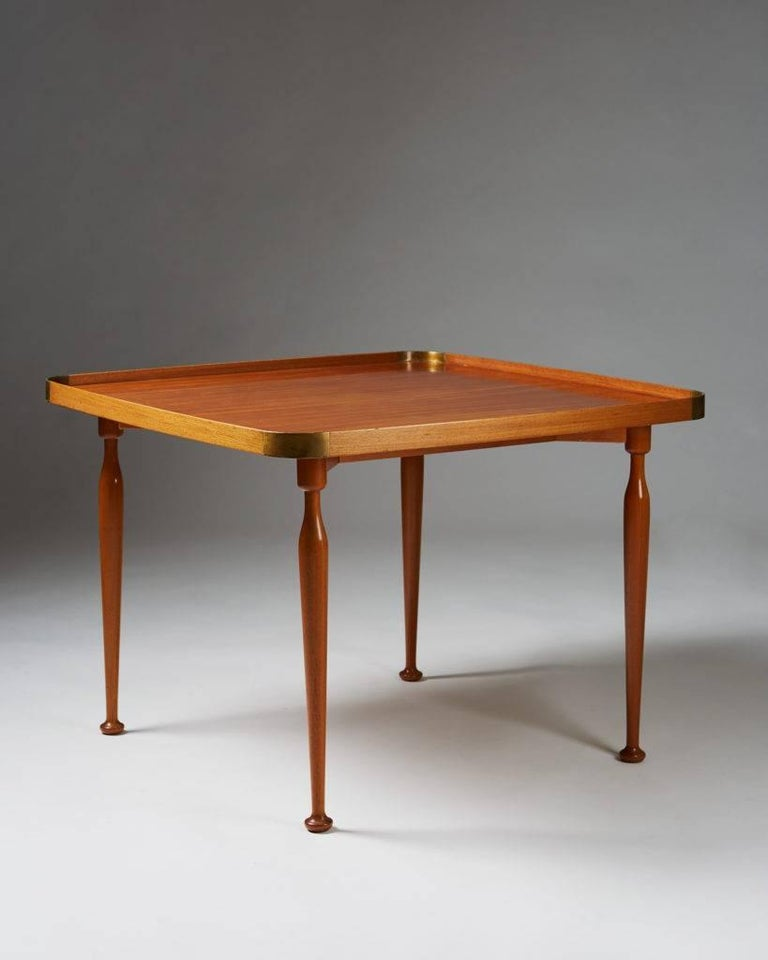 Occasional table model 1074 designed by Josef Frank for Svenskt Tenn, Sweden, 1950s.  Mahogany and brass.