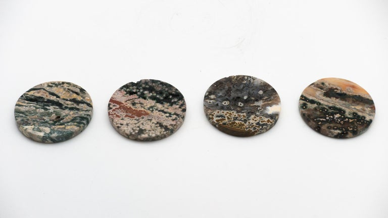 Set of four ocean jasper beverage coasters. Ocean jasper, or snakeskin jasper, is a combination of chalcedony, microcrystalline quartz and other minerals, resulting in colorful bands and patterns.