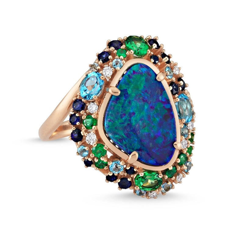 The Treasures of The Sea Collection is inspired by the water element which represents the treasures and natural stones hidden in the depths of the sea.  Oceanic ring in rose gold with blue opal and white diamond by Selda Jewellery  Additional