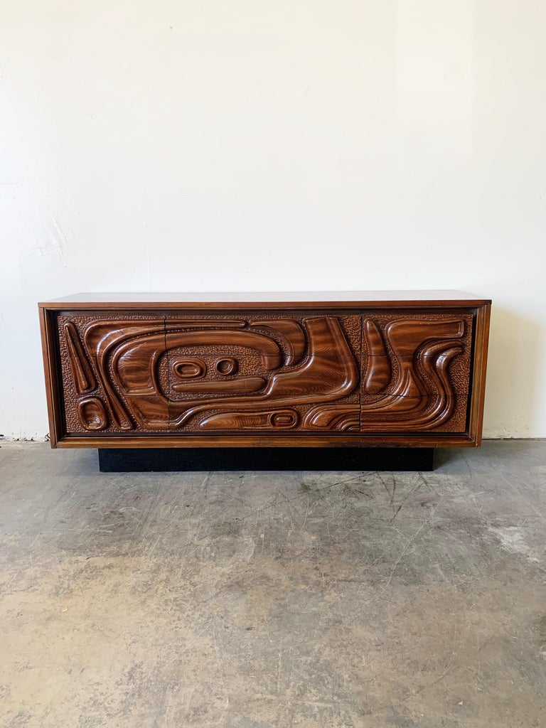 This fantastic lacquered sculpted walnut 'Oceanic' bedroom set is by Pulaski Furniture Corporation, circa 1969 which perfectly encapsulates the California surf mentality of the 1960s and 1970s, making this set highly sought after by Tiki collectors
