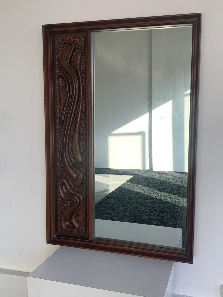 Mid-Century Modern Oceanic Sculpted Walnut Wall Mirror by Pulaski Furniture Co., circa 1969 For Sale