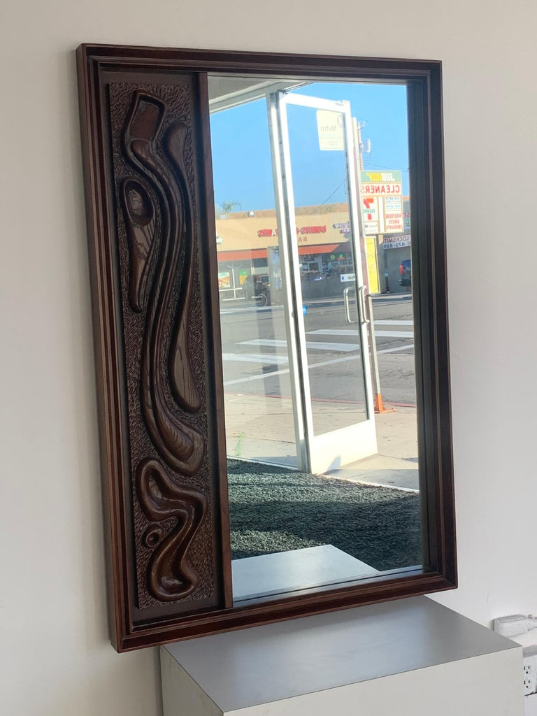 American Oceanic Sculpted Walnut Wall Mirror by Pulaski Furniture Co., circa 1969 For Sale