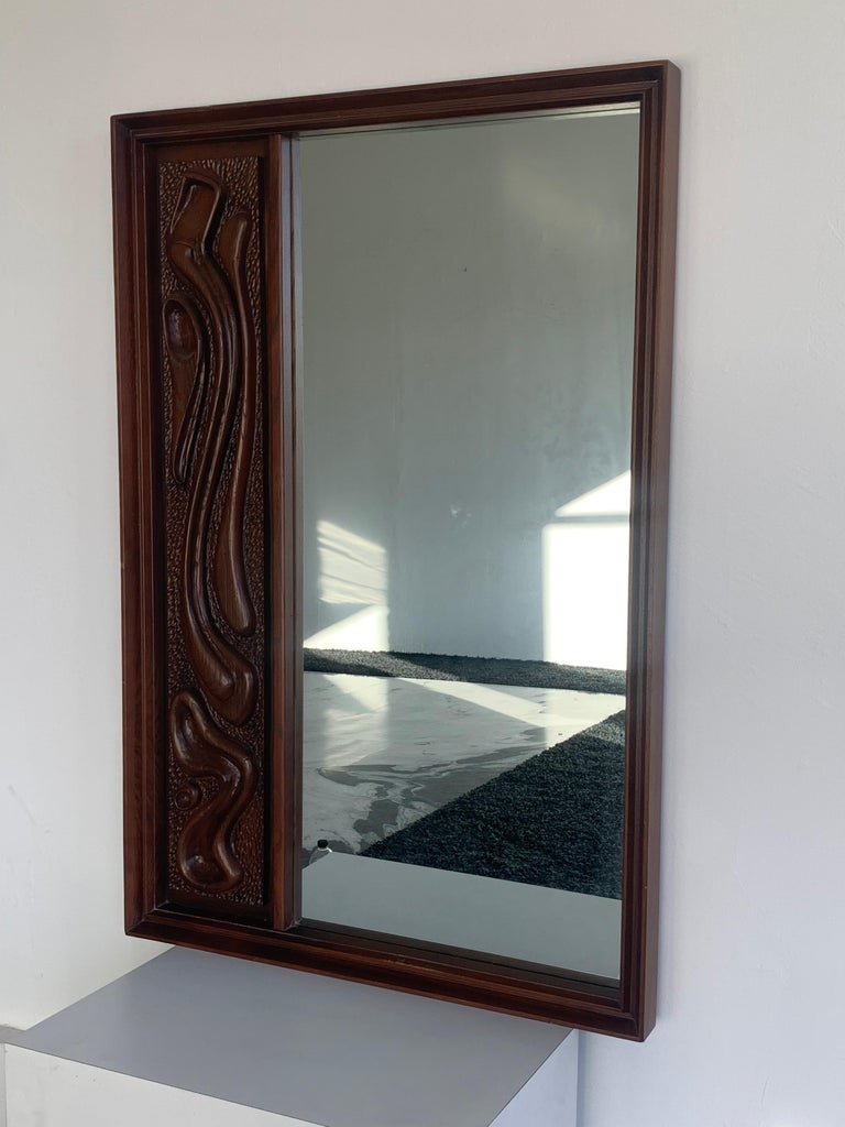Mid-20th Century Oceanic Sculpted Walnut Wall Mirror by Pulaski Furniture Co., circa 1969 For Sale