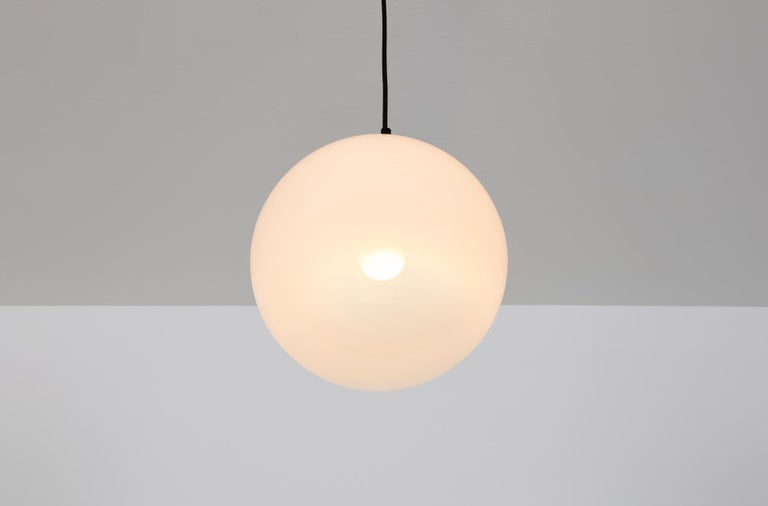 Opaque glass with gradient finish, chrome suspension. Medium size.   Multiple items also available in small and large size.    This misty white globe, in quality glass from Peill & Putzler, was manufactered by RAAK in the early 1970s. The