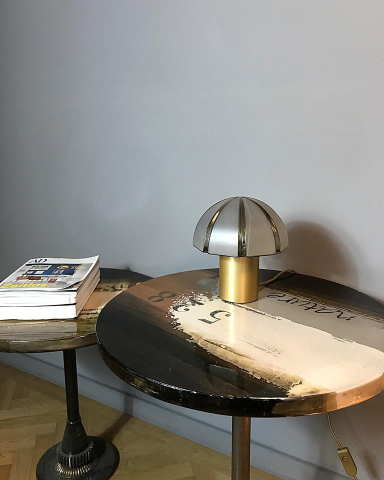 Elegant space age table lamp manufactured by Peill & Putzler in Germany. The lamp features a brass base with a mouth-blown lampshade in octagon cut that provides smooth and wonderful light. The lamp is in excellent condition.  Fully working rewired