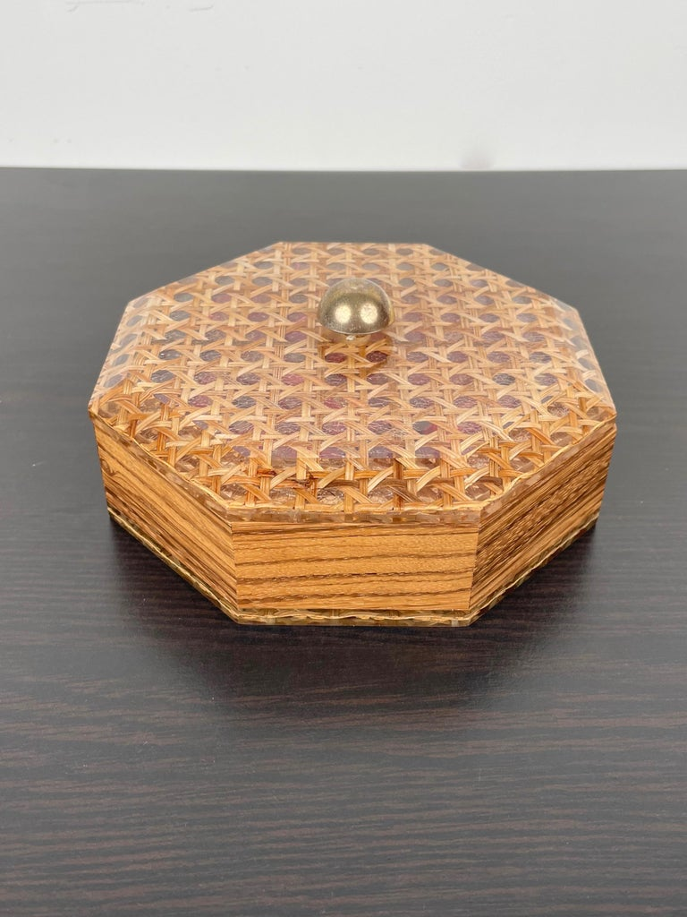 Octagonal box in Lucite, wicker and wood with a brass knob in Christian Dior style. Made in France in the 1970s.