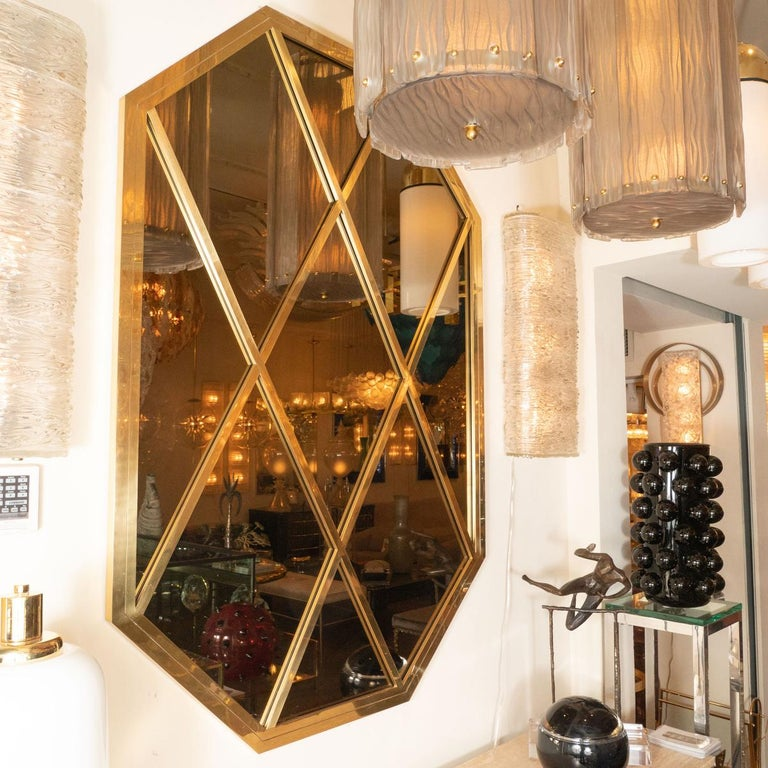Octagonal brass mirror with diamond design and smoked glass details by Romeo Rega.