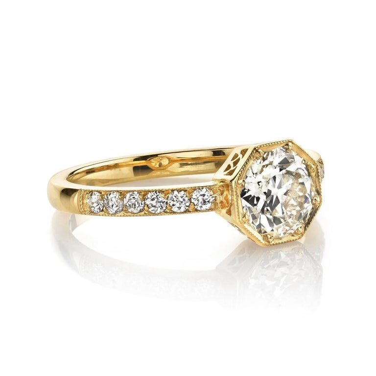 0.95ct M/VS1 EGL certified old European cut diamond set in a handcrafted 18k yellow gold mounting. Ring is currently a size 6 and can be sized to fit.