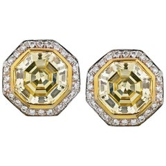 Octagonal Step Cut Diamond 9.62 Carat Fancy Yellow Halo Set GIA Certified Studs