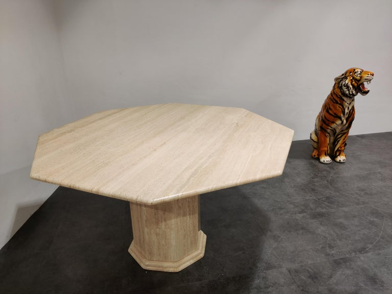 Beautiful dining table made from travertine stone with an octogonal base and top.  Nicely finished top.  Can be combined with many interior styles.  Good condition, normal wear.   1970s, Italy  Measures: Height 74cm/29.13