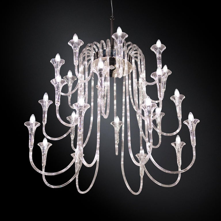 Part of the Octopus collection, this chandelier is a magnificent decorative and functional piece that will capture the eye and the imagination. Its structure comprises a top steel ring from which a cascade of 24 low-thermal-expansion borosilicate