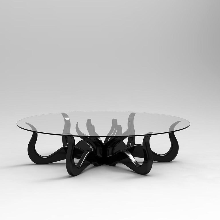 A solid wood, hand-carved table inspired by the organic movement of an Octopus. The tables base is as versatile as the invertebrate animals and can be inverted, allowing for your choice of two distinct looks: tentacles facing upward or downward. The