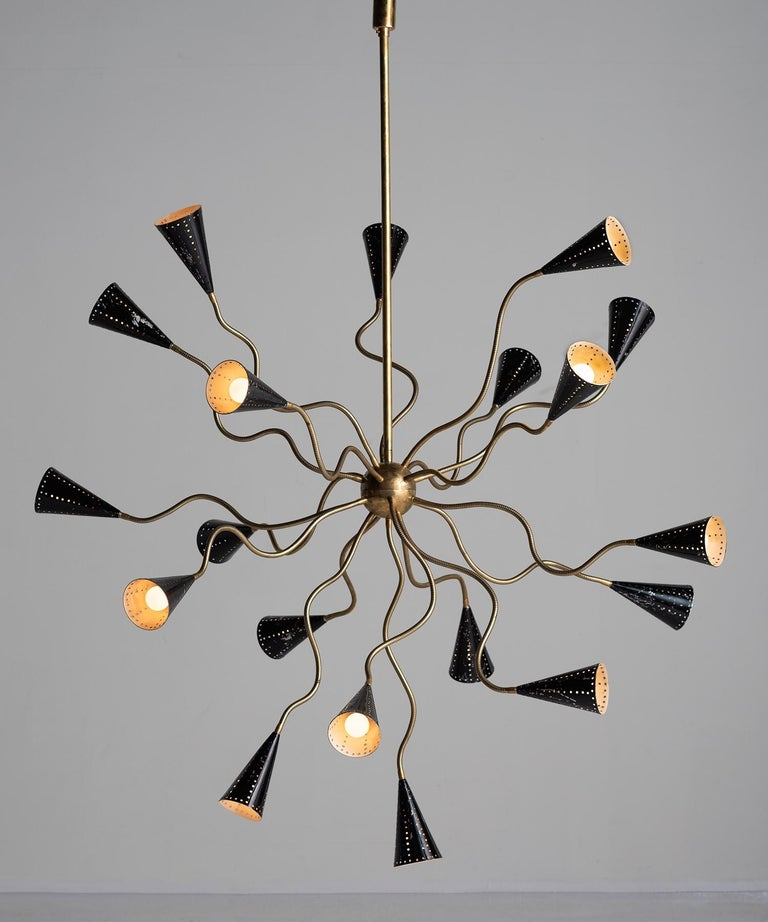Octopus Sputnik chandelier, Italy, circa 1960.  Metamorphic chandelier with 19 articulating brass arms and painted black perforated metal shades.