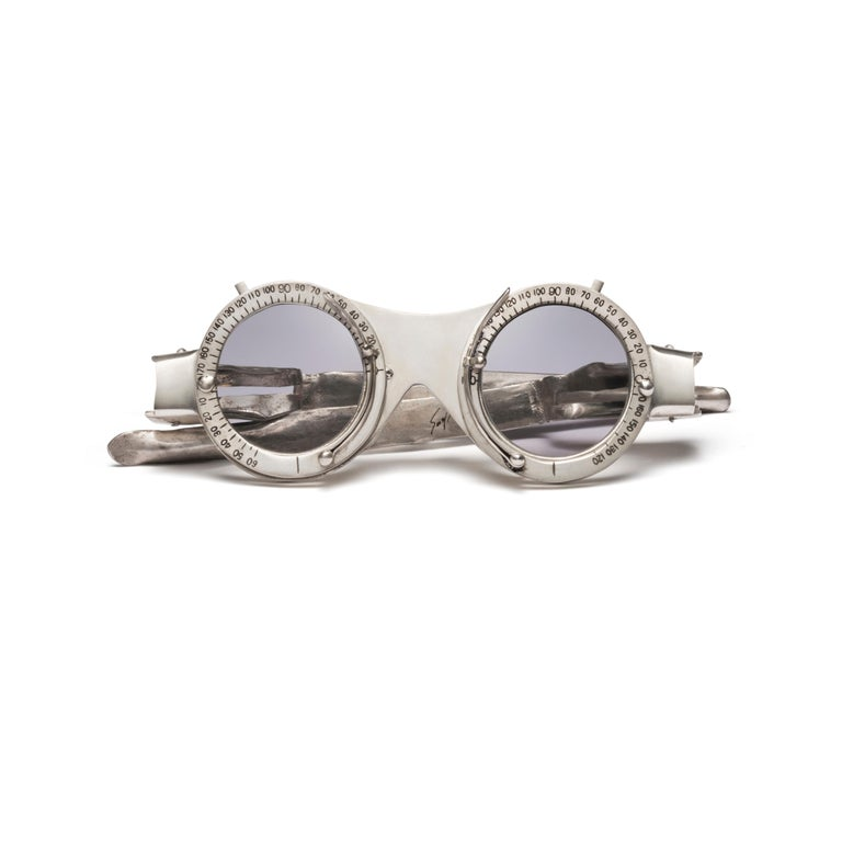 """One sterling silver eyeglasses, seven pairs of interchangeable tinted lenses, one Lacquer box with platinum foil  Produced by Lizworks and Selima Optique.  """"Oculist Witness"""" is comprised of a pair of sterling silver frames with a palette of"""