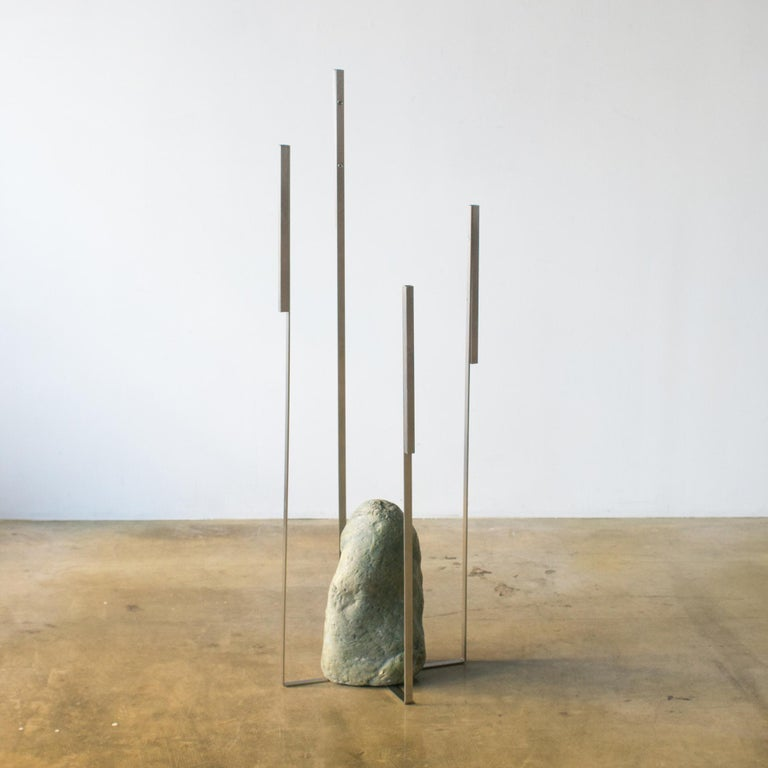Sculpture or sculptural vase for dried flowers designed by Batten and Kamp. Minimal structure furniture made of stainless steel and natural stone.