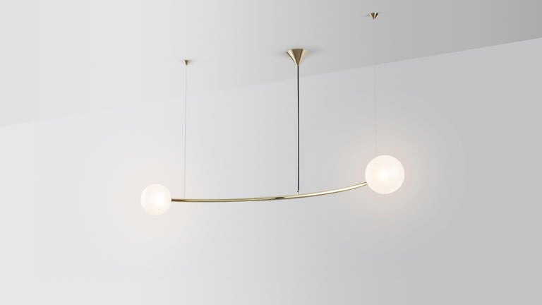 Oddments by Volker Haug  Dimensions: W 95, D 160, H 40 cm Materials: Polished or bronzed brass Finish: Raw, satin lacquer or enamel Cord / Cable: Black fabric / stainless steel Suspension: minimum 40 cm  Lamp: G9 - LED or Halogen 240V (120V