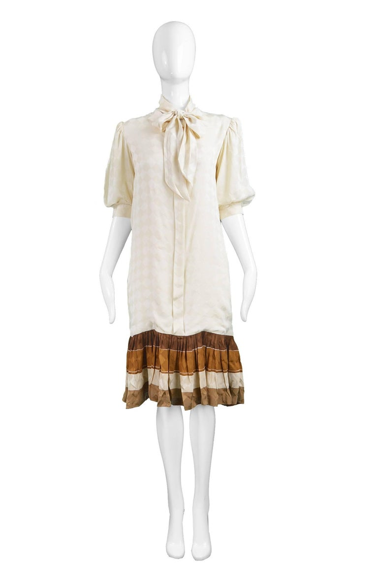 "Andrea Odicini Cream & Brown Silk Drop Waist Shift Dress with Pussy Bow, 1980s  Estimated Size: Women's Medium. Please check measurements.   Bust - 38"" / 96cm Waist - 36""  / 91cm Hips - 38"" / 96cm Length (Shoulder to Hem) - 40"" / 101cm Shoulder to"
