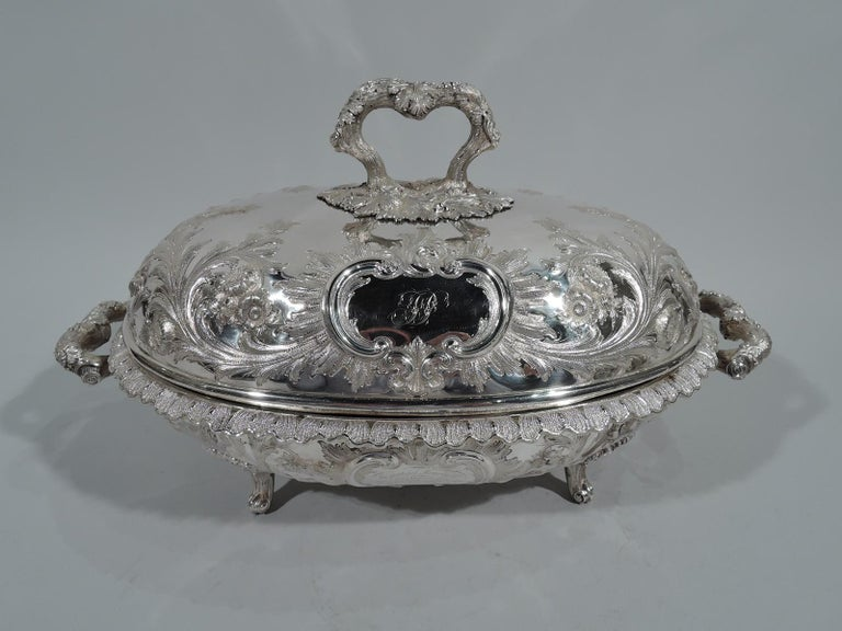 Of presidential interest – Covered sterling silver serving dish. Made by Bailey & Co. in Philadelphia. Ovoid bowl with turned-down and scalloped leaf rim, scrolled leaf-wrapped branch handles, and 4 leaf-mounted volute-scroll supports. Domed cover