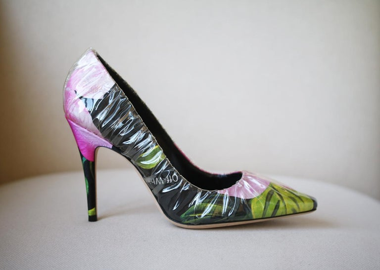 Dedicated to Princess Diana's enduring style and elegance, these 'Anne' pumps have been made in Italy from black satin printed with hothouse florals, then wrapped in clear PVC to resemble glass slippers. Heel measures approximately 100mm/ 4 inches.