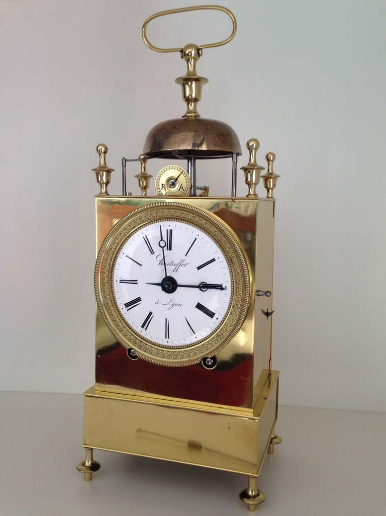 A fine French brass Capucine Officers clock, circa 1820, by well regarded maker Hastroffer a Lyon who specialised in this type of clock.  The clock is of typical form with doors to the sides and rear for access to the movement and pendulum, urn