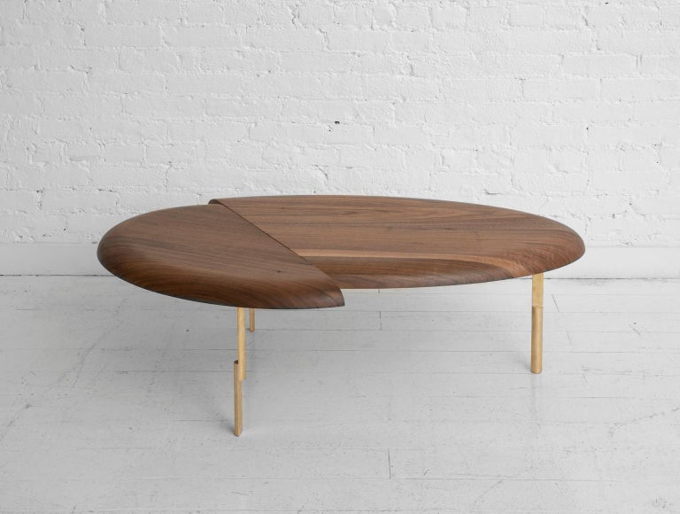 The first step in a series of side, coffee and dining tables based on the play between collaged biomorphic shapes and the contrast of rounded edges with cut planes.   It is a piece that can be experienced in different ways depending on the angle