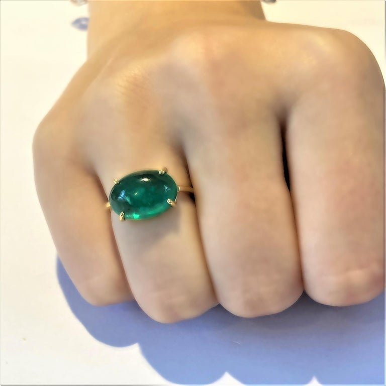 Eighteen Karat yellow gold emerald ring  Cabochon emerald weighing 6.70 carat        Emerald measuring 14x12 millimeter                                                         Ring size 5 In Stock Ring can be resized  New Ring Handmade in USA Our