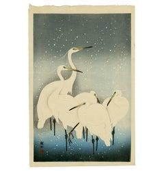 Egrets on a Snowy Night
