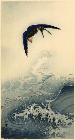 Swallow over the Ocean Waves