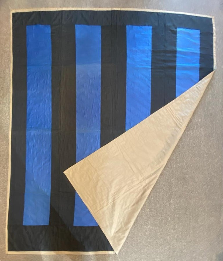 This fine polished cotton black & blue Amish bars quilt is signed & dated 1947 in the corners of the quilt.It is quilted in numbers. The condition is very good with minor fold marks in the center of the quilt, very faint.