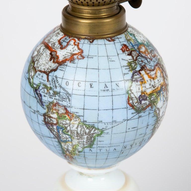 European Oil Lamp with an Illuminating Globe Shade, circa 1885 For Sale