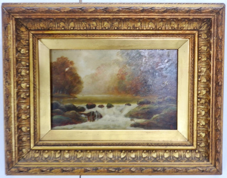 Pair of artist signed oil on board landscape paintings encased in ornate gilt frames. The paintings are signed with initials. Painted on prepared Students' Academy Board by Wilson & Newton of London, England. This company was founded in the 1830s.