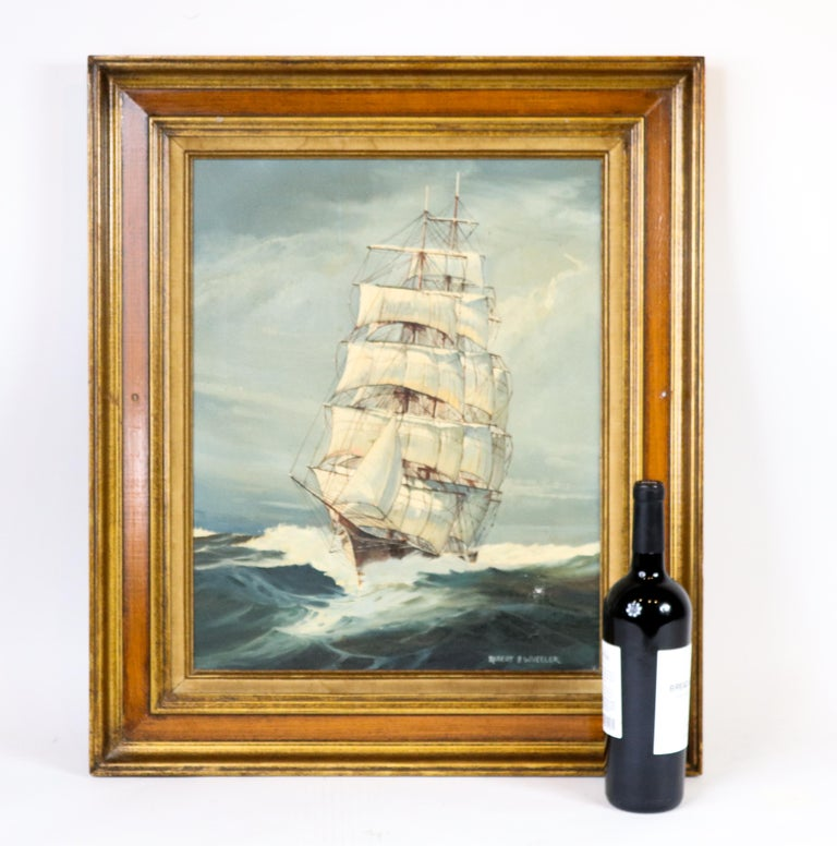 Oil on canvas painting of a clipper ship by Robert P. Wheeler in wood frame. Measures: 27 x 23.