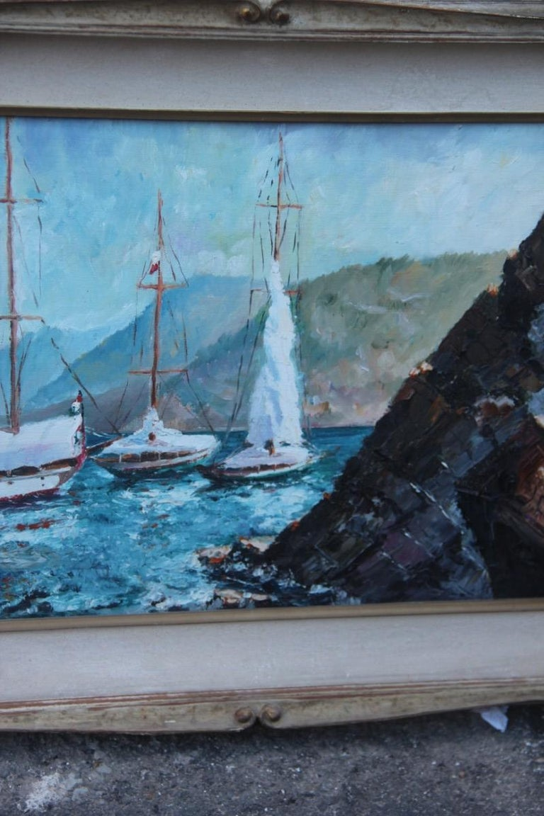 Oil on cardboard boats on the sea in 1940 with lacquered frame.